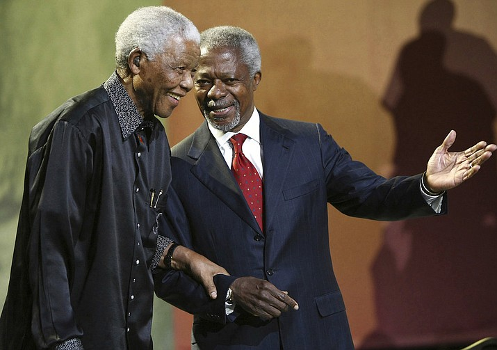 In this Sunday, July 22, 2007 file photo Nelson Mandela and former United Nations Secretary General Kofi Annan arrive together at the 5th Nelson Mandela Annual Lecture, held at the Linder Auditorium in Johannesburg, South Africa. Annan, one of the world's most celebrated diplomats and a charismatic symbol of the United Nations who rose through its ranks to become the first black African secretary-general, has died. He was 80. (AP Photo, File)