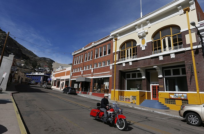 Shops and restaurants line the main street in this once bustling mining town Sunday, Feb. 17, 2013, in Bisbee, Ariz. When the city of Bisbee decided to remove fluoride from its water supply earlier this year, the vote was unanimous but there was no input from any public health entity, now public health officials say residents should be aware they are more susceptible to cavities. (Ross D. Franklin/AP)