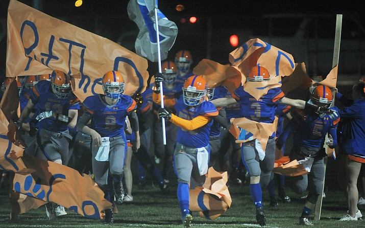 Chino Valley football players take the field in their 2017 game against the Kingman Bulldogs Friday, Oct. 7. The 2018 opener for the Cougars will be at NAU in Flagstaff. (Les Stukenberg/Courier, file)