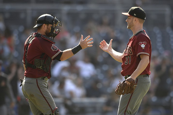 Arizona Diamondbacks' Brad Boxberger, right, and Jeff Mathis celebrate after recording the last out of a baseball game against the San Diego Padres, Sunday, Aug. 19, 2018, in San Diego. (Orlando Ramirez/AP Photo)