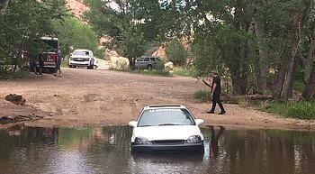 Driver gets stuck in water at Granite Creek crossing photo