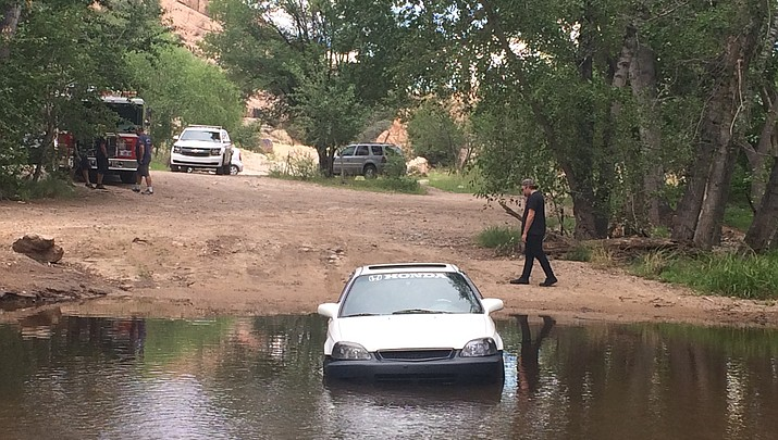 Driver gets stuck in water