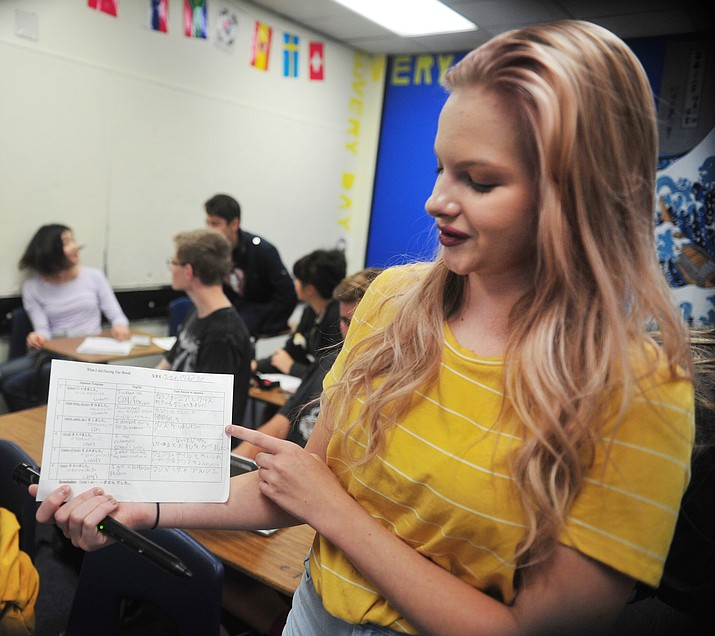 Sophomore Teagen McPherson shows some of her Japanese writing that she has learned during Japanese 2 class at Prescott High School Tuesday, August 15, 2018.  (Les Stukenberg/Courier)