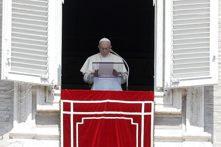 "In this Sunday, Aug. 19, 2018 photo, Pope Francis prays for the victims of the Kerala floods during the Angelus noon prayer in St.Peter's Square, at the Vatican. Pope Francis has issued a letter to Catholics around the world condemning the ""crime"" of priestly sexual abuse and cover-up and demanding accountability, in response to new revelations in the United States of decades of misconduct by the Catholic Church. (AP Photo/Gregorio Borgia, File)"