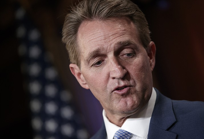 In this July 2018, file photo, Sen. Jeff Flake, R-Ariz., talks to reporters after making a speech on the Senate floor. The ranks of the forgotten Republicans are growing. They are members of Congress, governors and state party leaders who have been left behind by President Donald Trump's Republican Party and have been unwilling to sit quietly as the president steers the GOP away from free trade, fiscal responsibility, consistent foreign policy and civility. (AP file photo/J. Scott Applewhite)