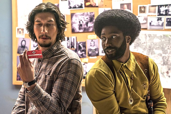BLACKkKLANSMAN stars John David Washington, who portrays  Ron Stallworth, a young, educated black man who wanted to be a law enforcement officer. He was the first black man hired by the Colorado Springs city police department.