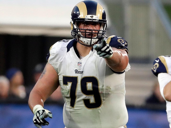 Los Angeles Rams offensive tackle Rob Havenstein (79) points to a player during the first half of an NFL football game against the Atlanta Falcons in Los Angeles, Dec. 11, 2016. Havenstein on Monday, Aug. 20, 2018 agreed to terms of a four-year contract extension through the 2022 season. (Rick Scuteri/AP Photo, file)