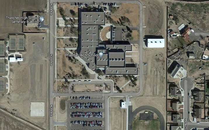 Police in the small southeastern Arizona town of Thatcher say Robert Layton drove to the high school parking lot around 11:45 p.m. Friday and complained about the loud music. (Google Earth photo)