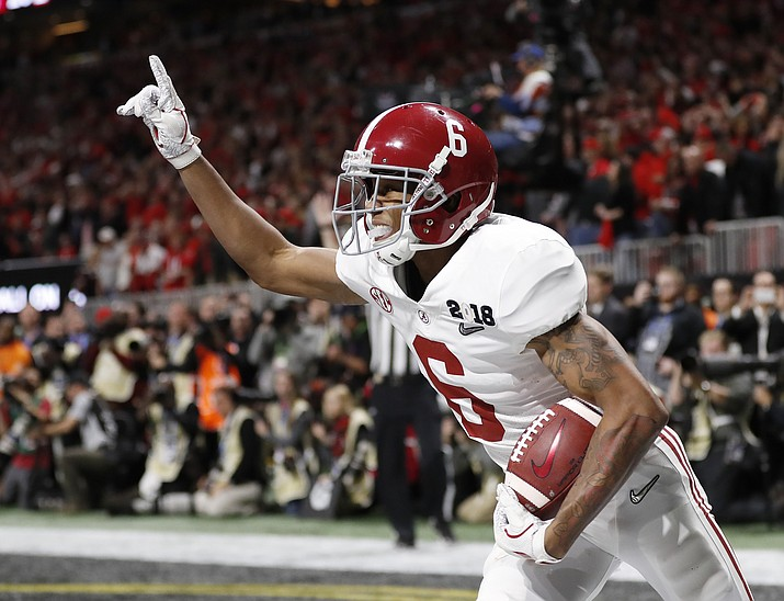 In this Jan. 8, 2018, file photo, Alabama wide receiver DeVonta Smith (6) celebrates his touchdown during overtime of the NCAA college football playoff championship game against Georgia, in Atlanta. The AP preseason Top 25 is out, and for the third straight year Alabama is No. 1. (AP Photo/David Goldman, File)