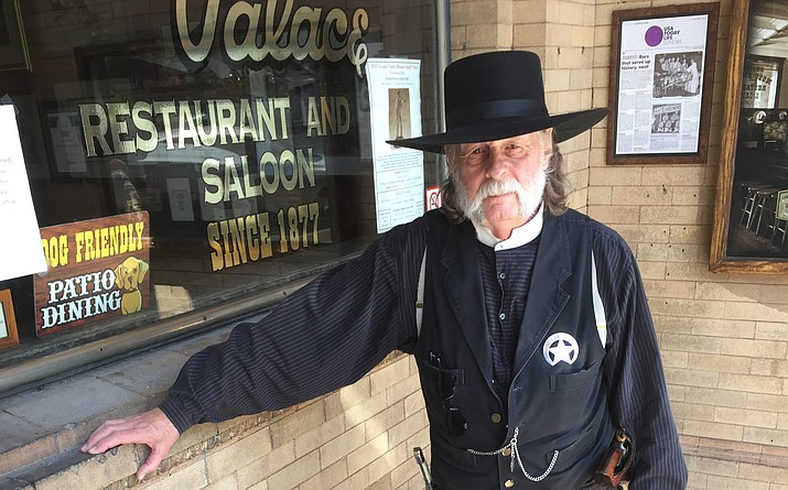"Palace Restaurant and Saloon maître d' Steve Waller — aka ""Marshall Steve"" — stands atop the antique glass bricks to be removed in front of the restaurant's entrance. (George Lurie/Courier)"