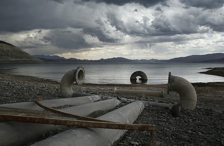 In this May 18, 2015, file photo, water intake pipes that were once underwater sit above the water line along Lake Mead near Boulder City, Nevada. U.S. government water managers said Lake Mead will be able to meet the demands of Mexico and Southwestern states for the next 13 months, but a looming shortage could trigger cutbacks in late 2019. (AP Photo/John Locher, File)