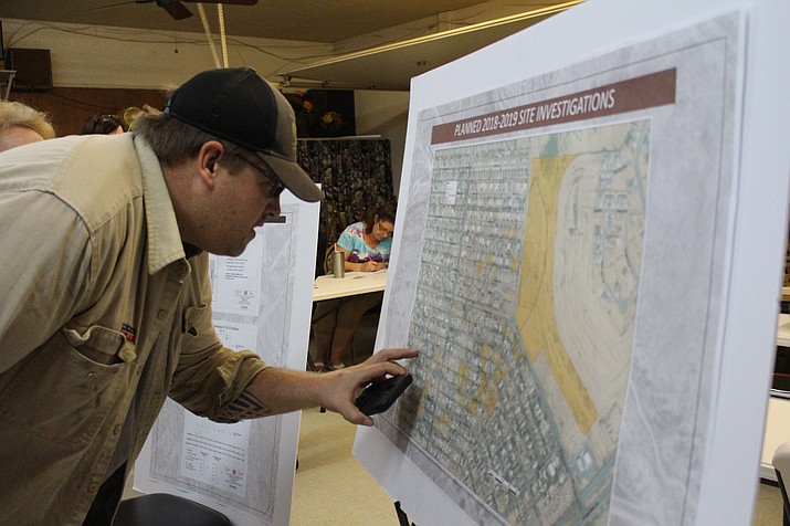 Butler resident Craig Reese finds the location of his property on a map of the U.S. Army Corps of Engineers' investigation sites for contaminated soil from a World War II gunnery training range. (Hubble Ray Smith/Daily Miner)
