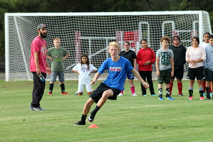 Middle school soccer players run conditioning drills under coach Jesse Magana. (Erin Ford/WGCN)