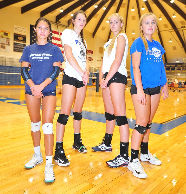Prescott's Sabina Dimaano-Simmons, Dani Dreher, Kate Radovich and Tessa Rothfuss, who are expected to make an impact this season, pose for a picture at practice Friday, Aug. 17, 2018. (Les Stukenberg/Courier)