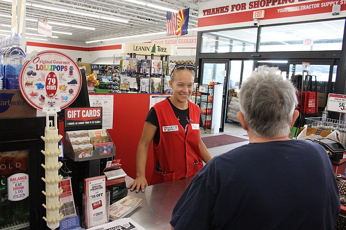 Melissa Bencker rings up a customer Tuesday at Tractor Supply Company. The store at 3136 N. Stockton Hill Road is holding a pet adoption and supplies drive from 9 a.m. to 2 p.m. Saturday. (Hubble Ray Smith/Daily Miner)