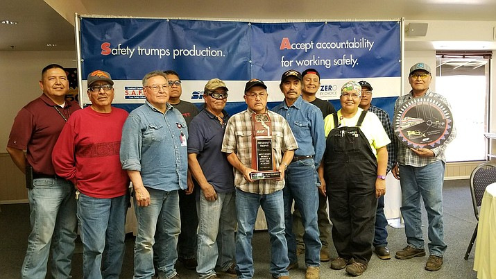 Members on the NGS Railroad & Heavy Equipment Dept. display this years SRP President's Trophy. From left: Ray John, Irvin Frank, Leslie Keep, Loren Clark, Ray Begay, Frank Tunney, Dallas Ross, Quanah Smith, Darlene Dodson, Will Riggs and Stanley Fowler. (Photo/Kerrie Lane)