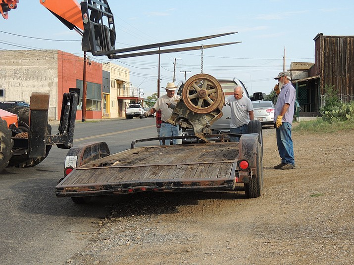 A few workers load up Historical Society Museum equipment onto a flat-bed trailer on Aug. 11 in Dewey Humboldt. (Historical Society Museum/Courtesy)