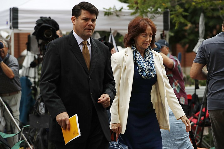 Paul Manafort's wife Kathleen Manafort, right, walks with Manafort spokesman Jason Maloni, to federal court for jury deliberations in the trial of the former Trump campaign chairman, in Alexandria, Va., Tuesday, Aug. 21, 2018. (Jacquelyn Martin/AP)