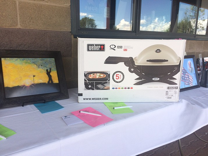 Some of the items in the silent auction during the 10th annual Bob Kaecker Memorial Golf Tournament, put on by the Chino Valley Area Chamber of Commerce at Antelope Hills Golf Course Saturday, Aug. 18. (Jason Wheeler/Courier)
