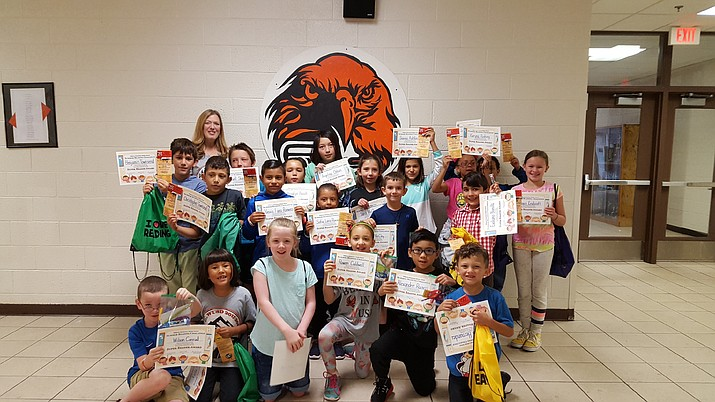 Summer reading challenge winners display certificates earned for reading the most throughout the summer. (Submitted photo)