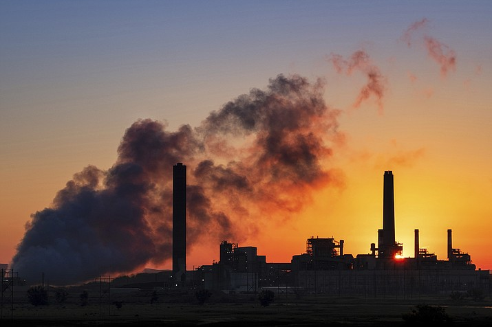 In this July 27, 2018 photo, the Dave Johnson coal-fired power plant is silhouetted against the morning sun in Glenrock, Wyo. The Trump administration on Tuesday proposed a major rollback of Obama-era regulations on coal-fired power plants, striking at one of the former administration's legacy programs to rein in climate-changing fossil-fuel emissions. (J. David Ake/AP)