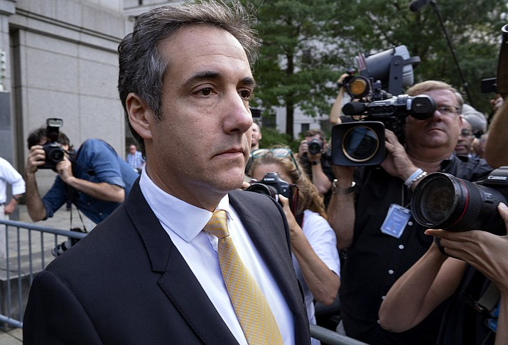 In this Aug. 21, 2018 file photo, Michael Cohen, former personal lawyer to President Donald Trump, leaves federal court after reaching a plea agreement in New York. Investigators in New York state issued a subpoena to Cohen as part of their probe into the Trump Foundation, an official with Democratic Gov. Andrew Cuomo's administration confirmed to The Associated Press on Wednesday, Aug. 22. (Craig Ruttle/AP, file)