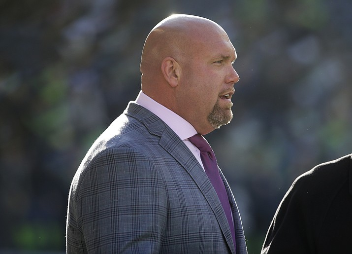 """In this Dec. 31, 2017, file photo, Arizona Cardinals general manager Steve Keim stands on the field before the team's NFL football game against the Seattle Seahawks in Seattle. A day after he returned to work from a five-week suspension, Keim apologized Wednesday, Aug. 22, 2018, to the organization, the team's fans and """"most of all"""" his family for the DUI arrest that forced his absence. (John Froschauer/AP, file)"""