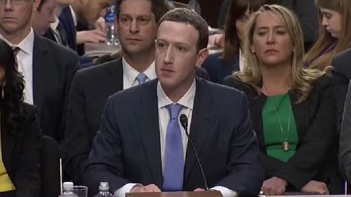 "Facebook CEO Mark Zuckerberg is questioned by the U.S. Senate in April. Facebook said Tuesday, Aug. 21, 2018, that it had removed 652 pages, groups, and accounts linked to Russia and Iran for ""coordinated inauthentic behavior"" that included the sharing of political content amid stepped-up policing of its own platform ahead of the U.S. midterm elections in November. (U.S. Senate image)"