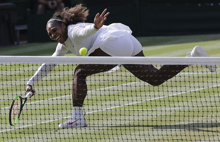 Serena Williams returns the ball during a women's singles final match at the Wimbledon Tennis Championships in London, July 14, 2018. (Ben Curtis/AP, file)