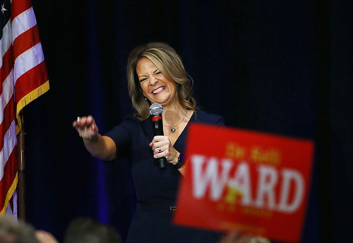 In this Oct. 17, 2017, file photo, former Republican Arizona state Sen. Kelli Ward smiles as she is greeted by supporters at a campaign fundraiser, in Scottsdale. Some Republican Party leaders warn that conservative candidates with problematic track records like Danny Tarkanian In Nevada or Arizona state Sen. Kelli Ward can't win general election battles and will lead the GOP to lose seats in 2018. (Ross D. Franklin/AP, file)