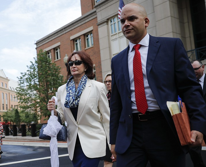Paul Manafort's wife Kathleen Manafort, left, leaves federal court with defense lawyer Jay Nanavati, right, after her husband Paul Manafort, the longtime political operative who for months led Donald Trump's winning presidential campaign, was found guilty of eight financial crimes in the first trial victory of the special counsel investigation into the president's associates in Alexandria, Va., Tuesday, Aug. 21, 2018.(AP Photo/Pablo Martinez Monsivais)