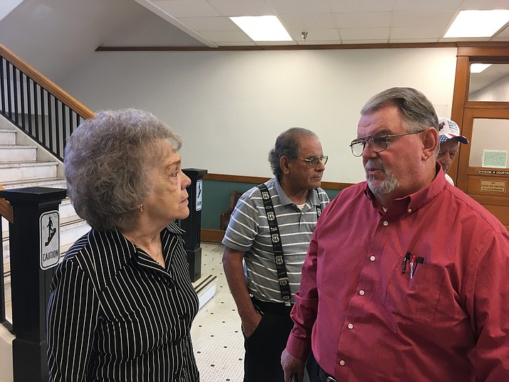 Patti Lewis, left, former chairwoman of the Northern Arizona Consolidated Fire District, and Valle Vista resident Rick Veradt talk in the hallway outside Judge Lee Jantzen's courtroom Thursday after their complaint against board member Carl Hays was upheld. (Hubble Ray Smith/Daily Miner)