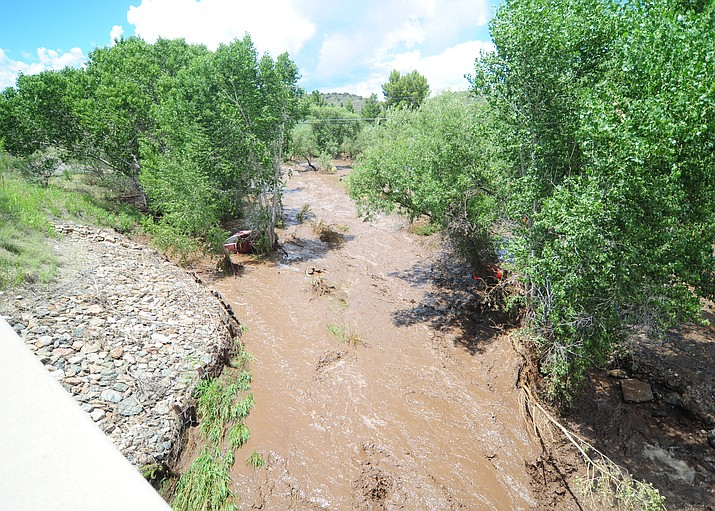 This file photo of Big Bug Creek from Aug. 4, 2017, shows flooding near Mayer. The Yavapai County Sheriff's Office called for mandatory evacuations for residents located in low lying areas near Big Bug Creek on Friday, Aug. 23, 2018. (Les Stukenberg/Courier, file)