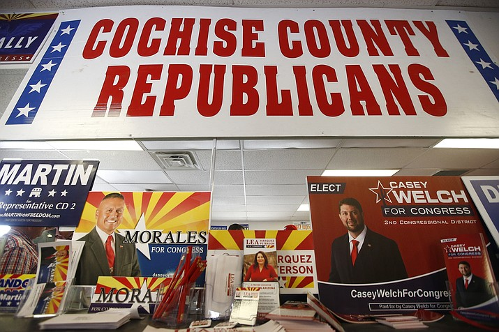 In this Aug. 6, 2018, photo, Campaign information for all the Republican candidates for the 2nd Congressional District are set up at a Republican party event in Sierra Vista, Ariz. Arizona's 2nd Congressional District is a primary battle as seven Democrats and four Republicans seek to succeed Republican Rep. Martha McSally, who is for a U.S. Senate seat. (Ross D. Franklin/AP)