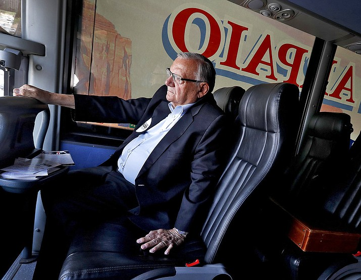 U.S. Senatorial candidate and former Maricopa County Sheriff Joe Arpaio rides on his campaign bus Thursday, Aug. 23, 2018, in Phoenix. Arpaio's Senate run will likely be the former sheriff's last political act, as he is expected to finish well outside the running in the GOP Senate primary. (AP Photo/Matt York)
