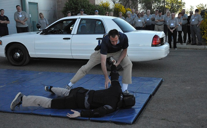 Northern Arizona Regional Training Academy (NARTA) recruits Greg Grahlmann (on top) and Wyatt Novak (on ground) perform a scenario during the spring 2017 Citizens' Police Academy.