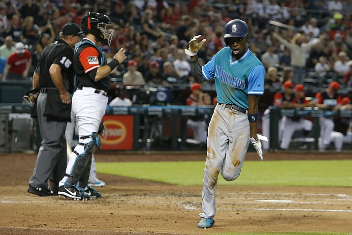 Seattle Mariners Dee Gordon celebrates after scoring on a throwing error by Arizona Diamondbacks pitcher Zack Godley after Gordon stole third base during the third inning of a baseball game Friday, Aug. 24, 2018, in Phoenix. (Rick Scuteri/AP)