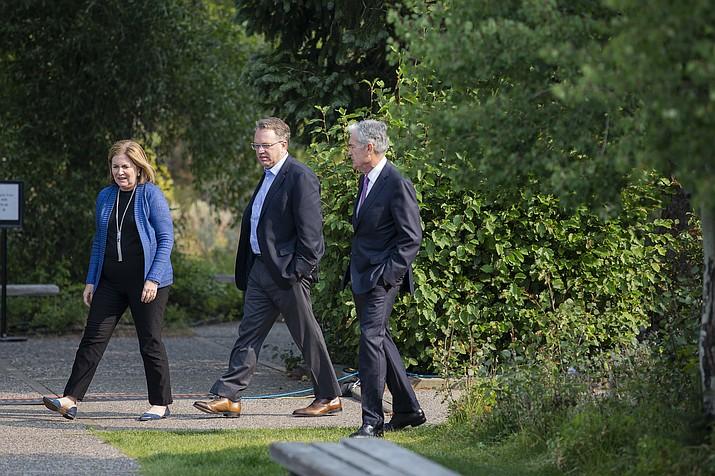 Esther George, left, President and CEO of the Federal Reserve Bank of Kansas City, John Williams, center, President and CEO of the Federal Reserve Bank of New York, and Jerome Powell, Chairman of the Board of Governors of the Federal Reserve System walk together after Powell's speech at the Jackson Hole Economic Policy Symposium on Friday, Aug. 24, 2018 in Jackson Hole, Wyo. Federal Reserve Chairman Jerome Powell signaled Friday that he expects the Fed to continue gradually raising interest rates if the U.S. economic expansion remains strong. (Jonathan Crosby/AP)
