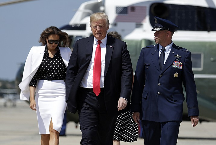President Donald Trump and first lady Melania Trump walk to board Air Force One for a trip to Columbus, Ohio to visit the National Children's Hospital, and to speak at the Ohio Republican State Party dinner, Friday, Aug. 24, 2018, in Andrews Air Force Base, Md. (Evan Vucci/AP)