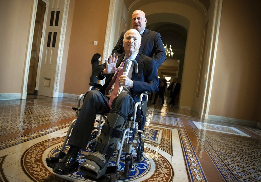 FILE - In this Dec. 1, 2017, file photo, Sen. John McCain, R-Ariz., leaves a closed-door session on Capitol Hill in Washington, where Republican senators met on the GOP effort to overhaul the tax code. Arizona Sen. McCain, the war hero who became the GOP's standard-bearer in the 2008 election, has died. He was 81. His office says McCain died Saturday, Aug. 25, 2018. He had battled brain cancer. (AP Photo/J. Scott Applewhite, File)