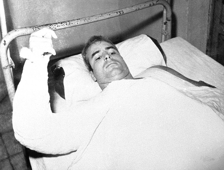 In this undated file photo provided by CBS, U.S. Navy Lt. Commander John S. McCain lies injured in North Vietnam. McCain, the war hero who became the GOP's standard-bearer in the 2008 election, died Saturday, Aug. 25, 2018. He was 81. (CBS via AP, File)