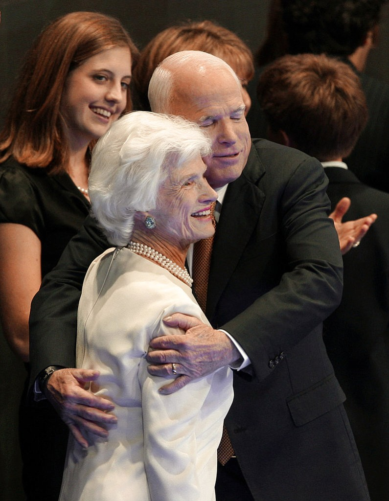FILE - In this Sept. 4, 2008, file photo, Republican presidential nominee John McCain embraces his mother, Roberta, following his acceptance speech at the Republican National Convention in St. Paul, Minn. Aide says senator, war hero and GOP presidential candidate McCain died Saturday, Aug. 25, 2018. He was 81. (AP Photo/Paul Sancya, File)