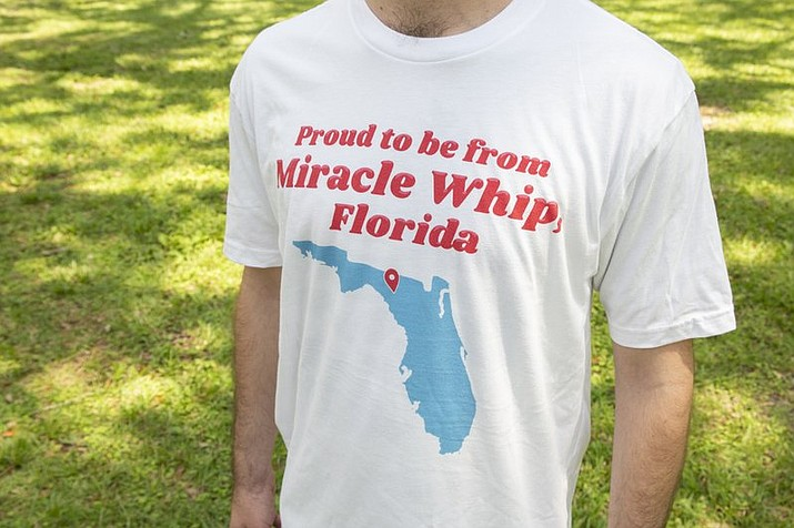 "This undated photo provided by the Kraft Heinz Company shows a person wearing a ""Miracle Whip"" shirt. The mayor of Mayo, Fla., a tiny town of less than 1,500 residents, located where Florida's Panhandle morphs into a peninsula, is announcing Saturday, Aug. 25, 2018, that the city is switching its name to ""Miracle Whip."" But it's a joke. The name change started as a secret, tongue-in-cheek marketing proposal for the Kraft Heinz-owned mayonnaise-alternative.(Kraft Heinz Company via AP)"