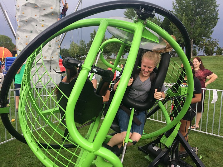 Louisa Hale, right, rides a gyroscope ride for the first time with Phoebe Allred at Prescott Valley's 40th Anniversary Celebration, Saturday, Aug. 25. The festivities continue Sunday. (Jason Wheeler/Courier)