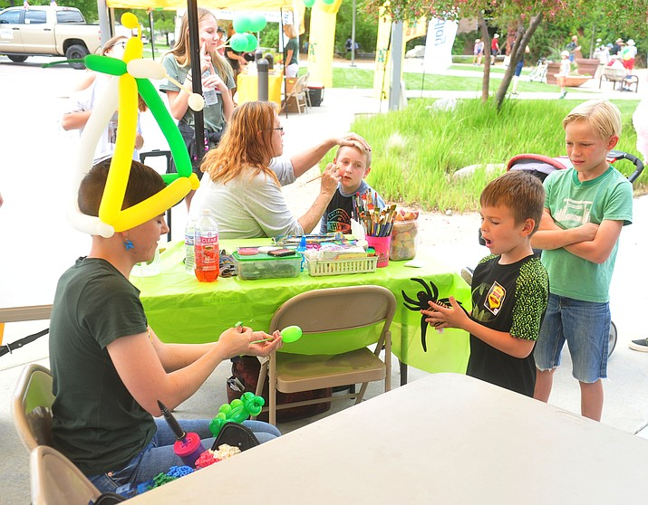 Face painting and balloon artists were on hand as Yavapai College celebrated its 50th anniversary at the Prescott campus Saturday, Aug. 25, 2018. (Les Stukenberg/Courier)