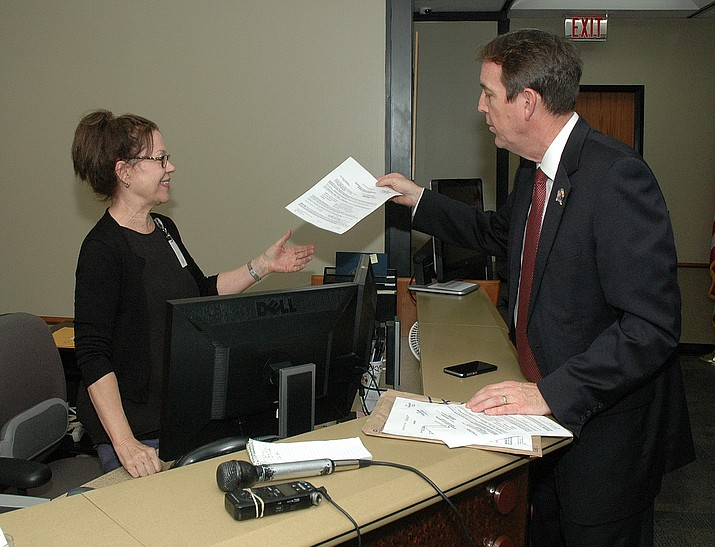 Gubernatorial hopeful Ken Bennett delivers a summons late Friday to Kari Benz at the Secretary of State's Office for a hearing Monday on his attempt to get more time to get $5 donations to qualify for public funding for his campaign. (Howard Fischer/Courtesy)