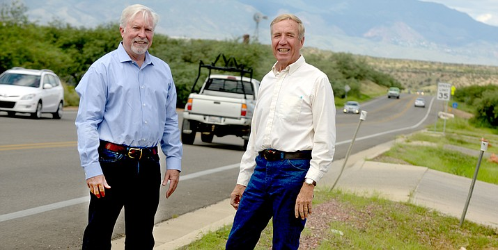 Yavapai County Supervisors Thomas Thurman and Randy Garrison  pose on Cornville Road after  announcing a $4.2 million highway safety improvement fund grant. VVN/Vyto Starinskas