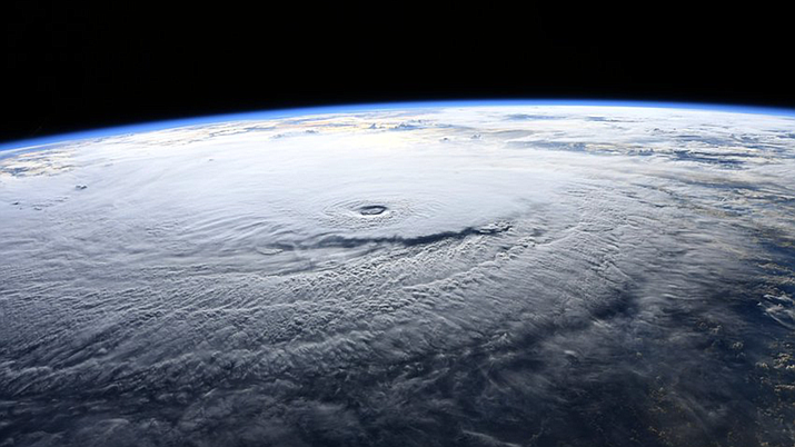 Hurricane Lane as seen from the International Space Station on Aug. 22. The storm has dumped nearly four feet of rain in some areas of the Big Island. Maui has seen about 12 inches of rain and wind gusts up to 50 mph in the past 24 hours. Both islands have reported flooding and landslides. (Photo from NASA)