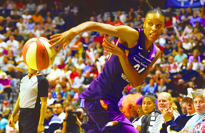 Phoenix Mercury forward DeWanna Bonner saves the ball from going out of bounds during the first half of a single-game WNBA basketball playoff matchup against the Connecticut Sun on Thursday, Aug. 23, 2018, in Uncasville, Conn. (Sean D. Elliot/The Day via AP)
