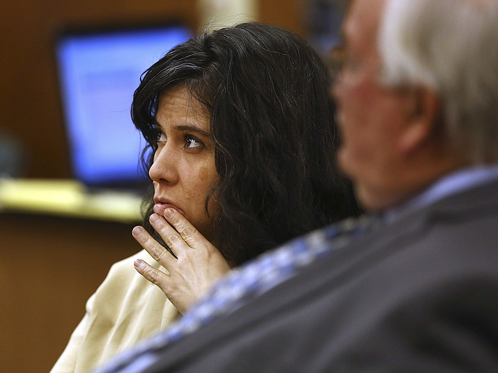 In this Dec. 2, 2015, file photo, Sophia Richter is shown at her trial on child abuse and kidnapping charges in Tucson, Ariz. She is accused of keeping her three daughters imprisoned in their Tucson home for three months. The Arizona Supreme Court on Friday, Aug. 24, 2018, threw out her convictions and ordered a new trial, saying the judge at her trial erred in barring her claims that she was compelled to commit the crimes by her husband's threats and immediate use of force. (Mike Christy/Arizona Daily Star via AP, file)
